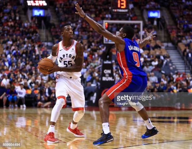 Delon Wright of the Toronto Raptors looks to pass the ball as Langston Galloway of the Detroit Pistons defends during the second half of an NBA...