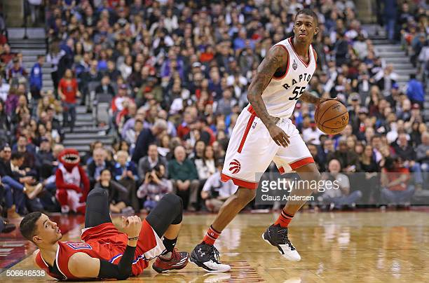 Delon Wright of the Toronto Raptors takes a foul against the Los Angeles Clippers during an NBA game at the Air Canada Centre on January 24 2016 in...