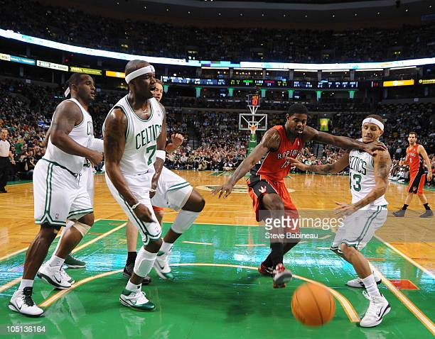 Delonte West and Jermaine O'Neal of the Boston Celtics look for loose ball against Amir Johnson of the Toronto Raptors on October 10 2010 at the TD...