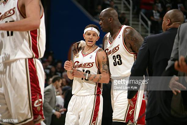 Delonte West and Shaquille O'Neal of the Cleveland Cavaliers discuss their next play during a break in the action against the Chicago Bulls in Game...