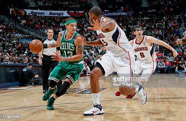 Delonte West of the Boston Celtics against Al Horford of the Atlanta Hawks at Philips Arena on April 1 2011 in Atlanta Georgia NOTE TO USER User...