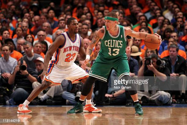 Delonte West of the Boston Celtics looks to pass against Toney Douglas of the New York Knicks in Game Four of the Eastern Conference Quarterfinals...