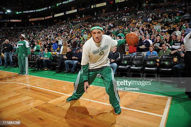 Delonte West of the Boston Celtics wears an NBA Green shirt as he warms up before a game against the Philadelphia 76ers on April 5 2011 at the TD...
