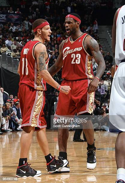 Delonte West of the Cleveland Cavaliers celebrates with LeBron James after dunking against the Atlanta Hawks on December 29 2009 at Philips Arena in...