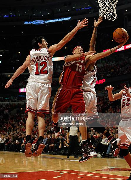 Delonte West of the Cleveland Cavaliers drives to the basket between Kirk Hinrich and Derrick Rose of the Chicago Bulls in Game Four of the Eastern...
