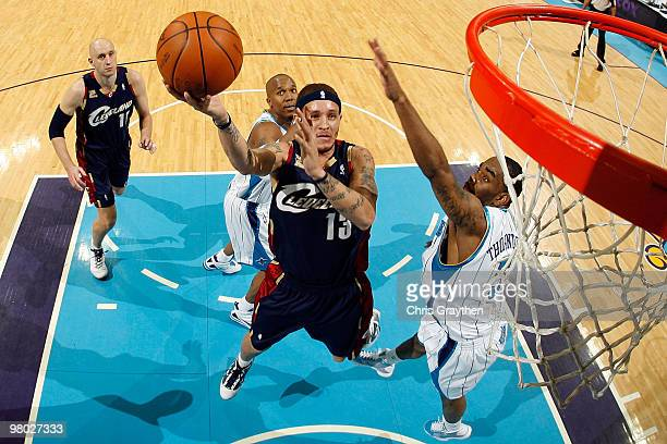 Delonte West of the Cleveland Cavaliers shoots the ball around Marcus Thornton of the New Orleans Hornets at the New Orleans Arena on March 24 2010...