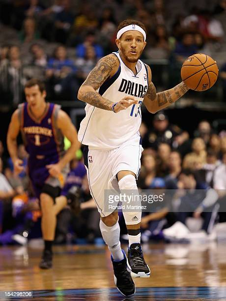 Delonte West of the Dallas Mavericks dribbles the ball against the Phoenix Suns during a preseason game at American Airlines Center on October 17...