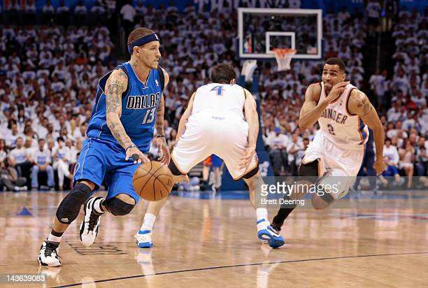 Delonte West of the Dallas Mavericks drives around Nick Collison of the Oklahoma City Thunder in Game Two of the Western Conference Quarterfinals in...