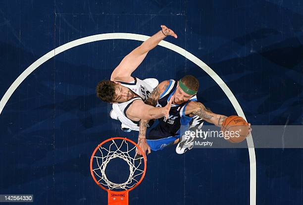 Delonte West of the Dallas Mavericks dunks over Marc Gasol of the Memphis Grizzlies on April 7 2012 at FedExForum in Memphis Tennessee NOTE TO USER...