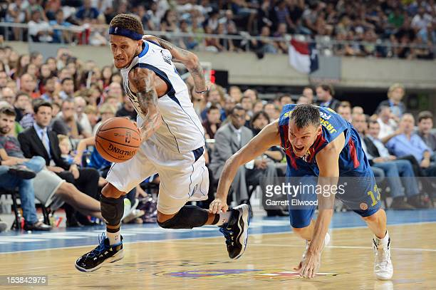 Delonte West of the Dallas Mavericks goes for the loose ball against Sarunas Jasikevicius of FC Barcelona Regal during NBA Europe Live 2012 on...