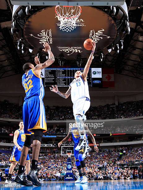 Delonte West of the Dallas Mavericks goes in for the layup against Mickell Gladness of the Golden State Warriors on April 20, 2012 at the American...