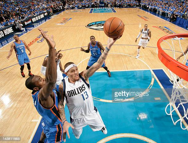 Delonte West of the Dallas Mavericks goes in for the layup against Serge Ibaka of the Oklahoma City Thunder in Game Three of the Western Conference...