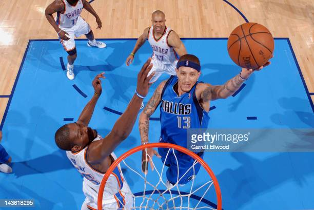 Delonte West of the Dallas Mavericks goes to the basket against Kevin Durant of the Oklahoma City Thunder in Game Two of the Western Conference...