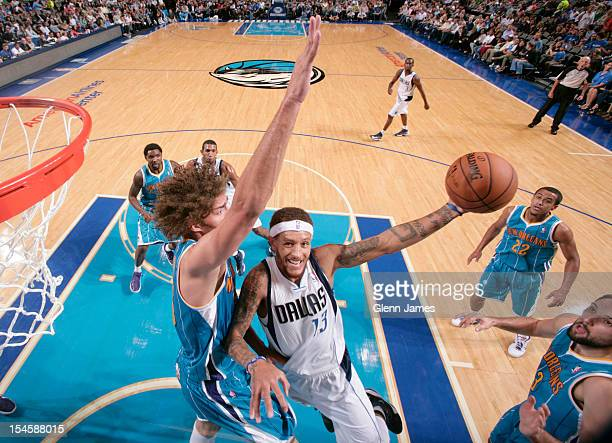 Delonte West of the Dallas Mavericks goes to the basket against Robin Lopez of the New Orleans Hornets on October 22 2012 at the American Airlines...