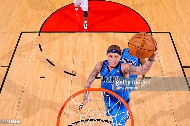 Delonte West of the Dallas Mavericks goes to the basket against the Portland Trail Blazers on April 13 2012 at the Rose Garden Arena in Portland...