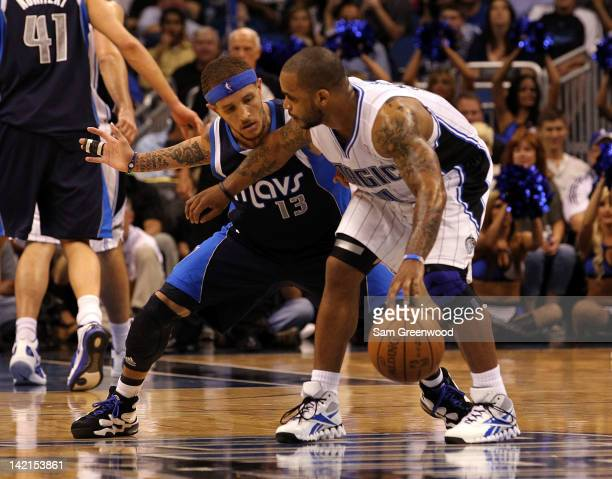 Delonte West of the Dallas Mavericks guards Jameer Nelson of the Orlando Magic during the game at Amway Center on March 30 2012 in Orlando Florida...