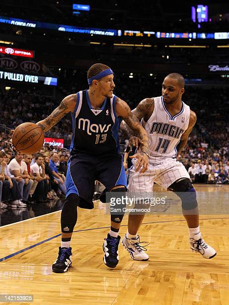 Delonte West of the Dallas Mavericks looks to pass against Jameer Nelson of the Orlando Magic during the game at Amway Center on March 30 2012 in...