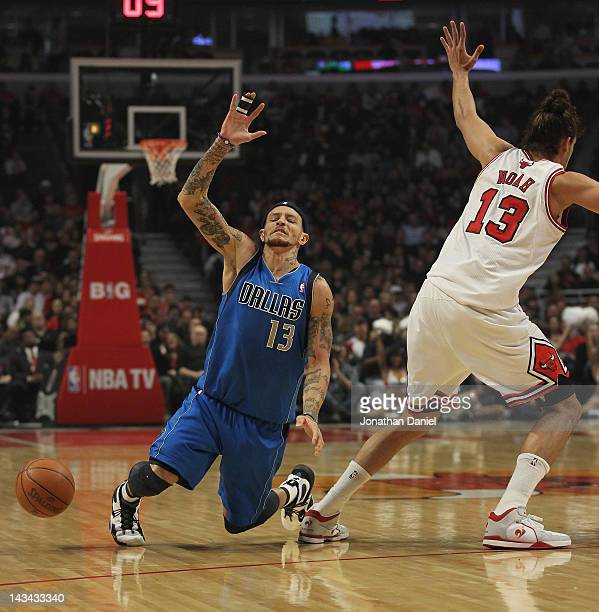 Delonte West of the Dallas Mavericks looses the ball after running into Jaokim Noah of the Chicago Bulls at the United Center on April 21 2012 in...