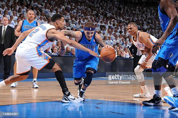 Delonte West of the Dallas Mavericks moves the ball against Thabo Sefolosha of the Oklahoma City Thunder in Game Two of the Western Conference...