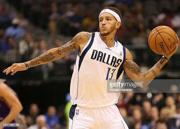 Delonte West of the Dallas Mavericks passes the ball against the Phoenix Suns during a preseason game at American Airlines Center on October 17 2012...