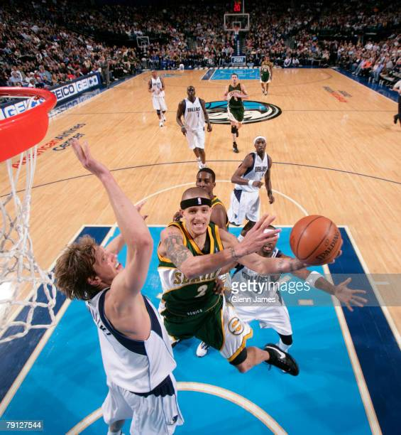 Delonte West of the Seattle SuperSonics goes in for the layup against Dirk Nowitzki of the Dallas Mavericks at the American Airlines Center January...