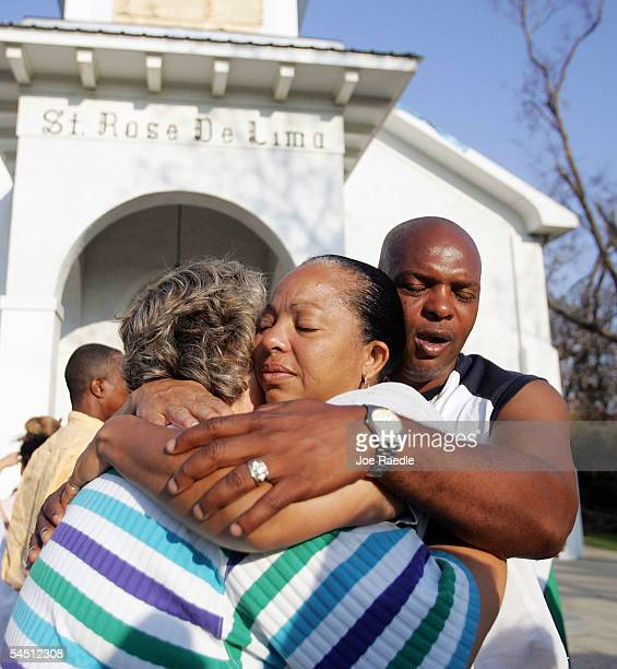 Delorise Dorsey and Sam Dorsey hug Terry McQueen as they leave the St Rose De Lima mass September 4 2005 in Bay St Louis Mississippi They all had...