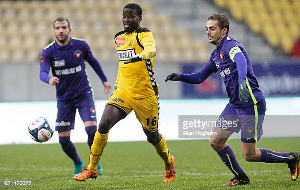 Delphin Tshiembe of AC Horsens and Jakob Poulsen of FC Midtjylland compete for the ball during the Danish Alka Superliga match between AC Horsens and...