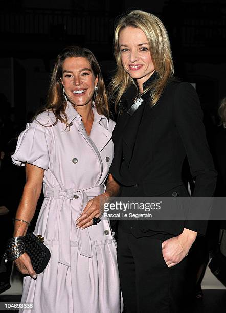 Delphine Arnault and guest attend the Givenchy Ready to Wear Spring/Summer 2011 show during Paris Fashion Week on October 3 2010 in Paris France