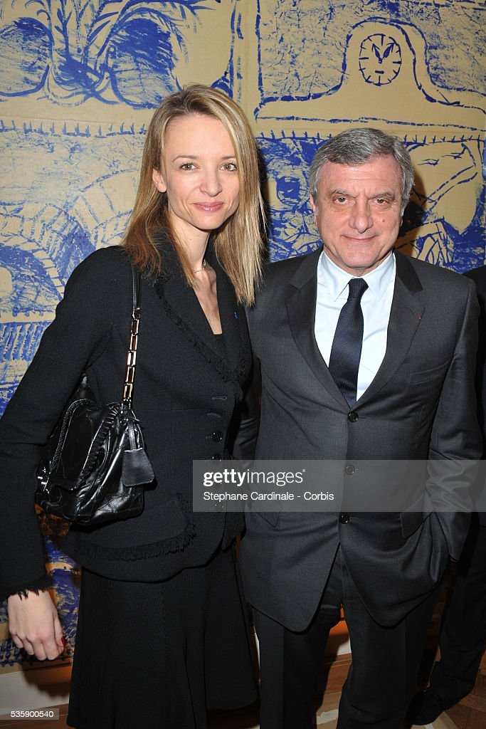 Delphine Arnault and Sidney Toledano attend the ceremony during which Marion Cotillard and Tim Burton were awarded the Order Of Arts and Letters, at the Department of Culture in Paris.