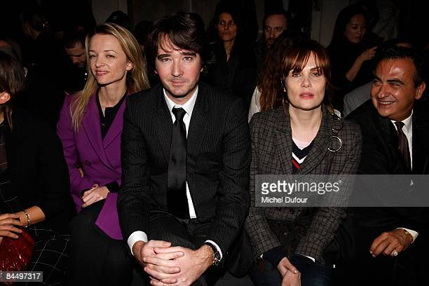 Delphine Arnault Antoine Arnault and Emmanuelle Seigner attends the Givenchy fashion show during Paris Fashion Week Haute Couture Spring/Summer 2009...