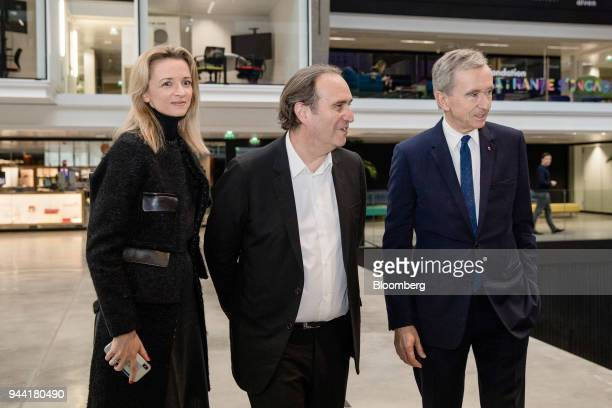 Delphine Arnault executive vice president of LVMH Moet Hennessy Louis Vuitton SE left Xavier Niel billionaire and deputy chairman of Iliad SA center...