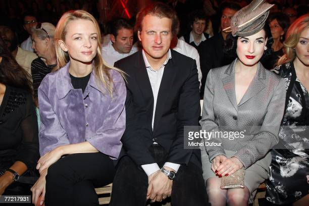 Delphine Arnault her husband Alessandro Vallarino Gancia Dita von Teese attend the John Galliano fashion show during the Spring/Summer 2008...