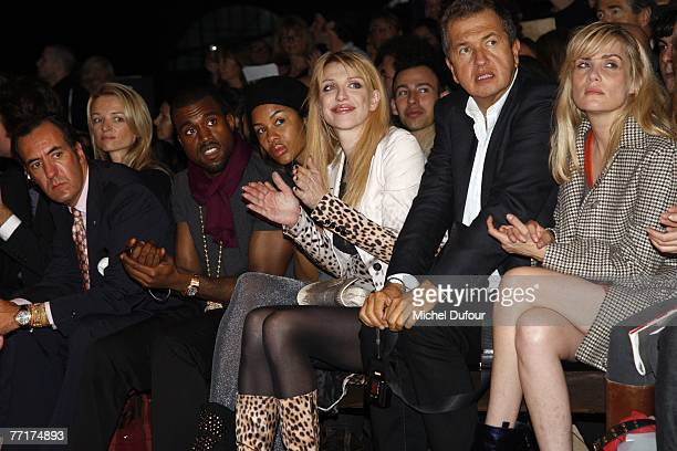Delphine Arnault Jaime de Marichalar Kanye West and his wife Courtney Love Mario testino and Emmanuelle Seigner attends the Givenchy fashion show...