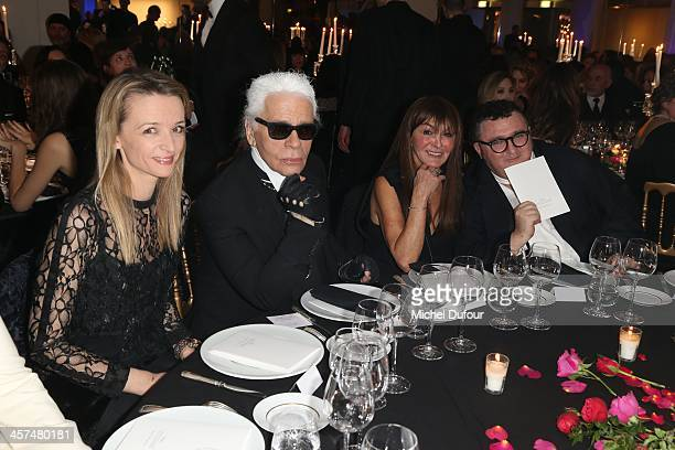 Delphine Arnault Karl Lagerfeld Babeth Djian and Albert Elbaz attend the Annual Charity Dinner Hosted By The AEM Association Children Of The World...