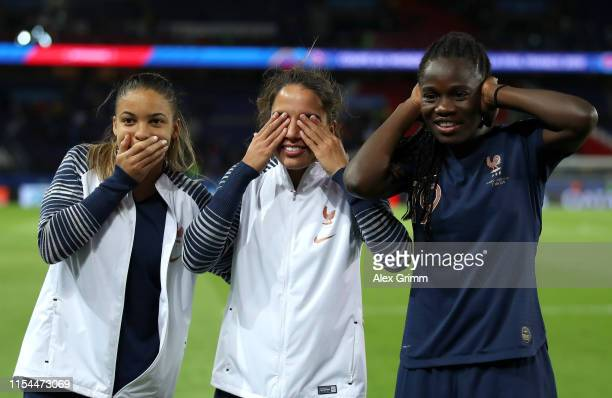 Delphine Cascarino Amel Majri and Griedge Mbock Bathy of France celebrate victory together after the 2019 FIFA Women's World Cup France group A match...