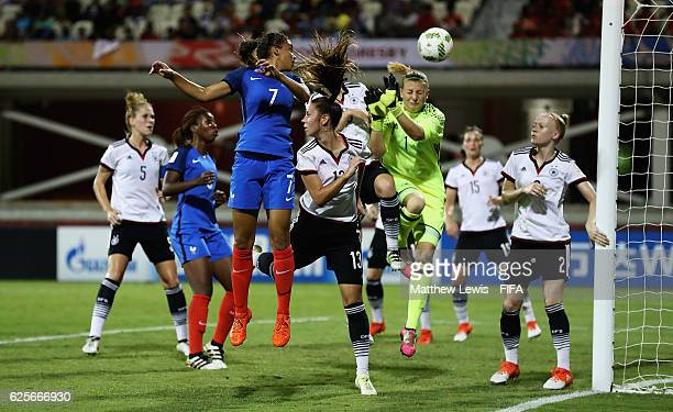 Delphine Cascarino looks to head the ball past Carina Schlueter of Germany during the FIFA U20 Women's World Cup Papua New Guinea 2016 Quarter Final...