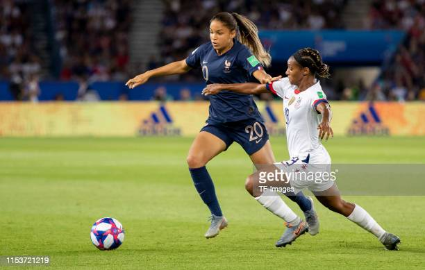 Delphine Cascarino of France and Crystal Dunn of USA battle for the ball during the 2019 FIFA Women's World Cup France Quarter Final match between...