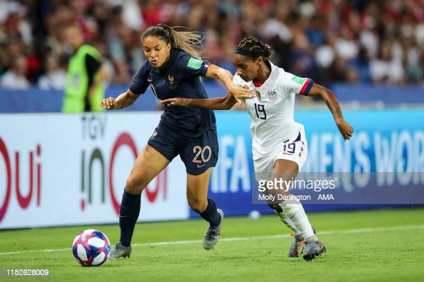 Delphine Cascarino of France and Crystal Dunn of USA during the 2019 FIFA Women's World Cup France Quarter Final match between France and USA at Parc...