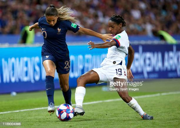 Delphine Cascarino of France competes for the ball with Crystal Dunn of USA during the 2019 FIFA Women's World Cup France Quarter Final match between...