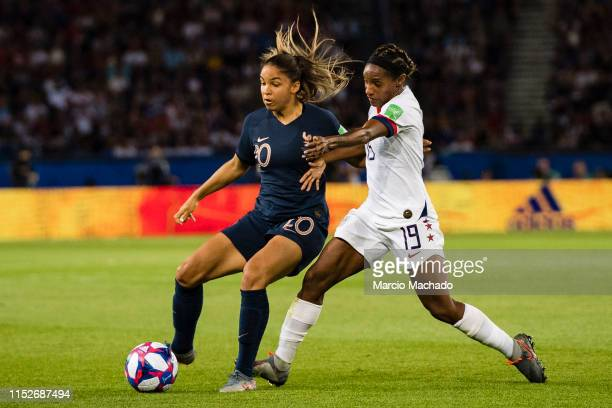 Delphine Cascarino of France fights for the ball with Crystal Dunn of United States during the 2019 FIFA Women's World Cup France Quarter Final match...