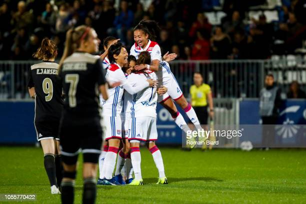 Delphine Cascarino of Lyon and Amel Majri of Lyon and Selma Bacha of Lyon and Saki Kumagai of Lyon celebrate during the UEFA Women's Champions League...