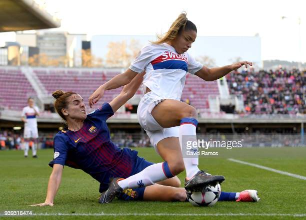 Delphine Cascarino of Olympique Lyon is tackled by Melanie Serrano of FC Barcelona during the UEFA Women's Champions League Quarter Final 2nd Leg...