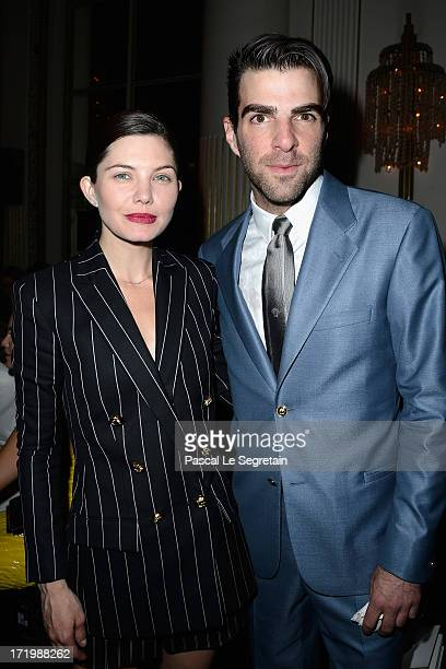 Delphine Chaneac and Zachary Quinto attend the Versace show as part of Paris Fashion Week HauteCouture Fall/Winter 20132014 at on June 30 2013 in...