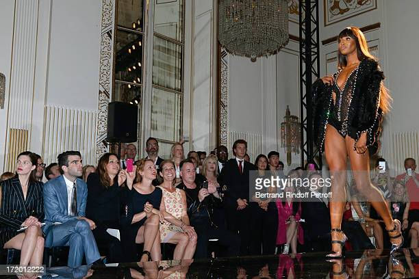 Delphine Chaneac Zachary Quinto Guest Uma Thurman Jo Levin and David Furnish watching model Naomi Campbell on the catwalk of the Versace show as part...