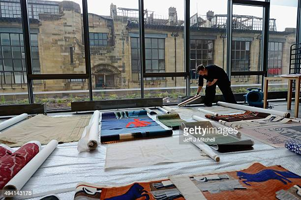 Delphine Dallison views saved tapestries as members of staff and specialist removers continue the retrieval of student art work from the Glasgow...