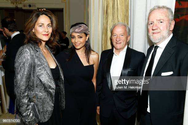 Delphine Malachard de Reyssiers guest JeanPaul Patreschi and Fabio Conversi attend the Liu Lisi Charity Gala Dinner with Unicef at Hotel Plaza...