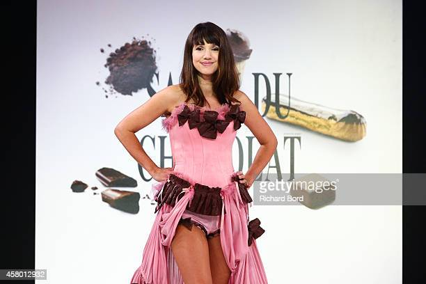 Delphine McCarty walks the runway and wears a chocolate costume made by designer Fifi Chachnil and chocolate maker Patrice Chapon during the Fashion...