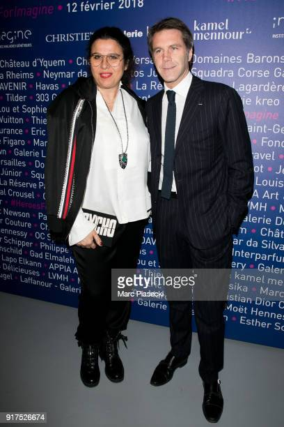 Delphine Pastor and EmmanuelPhilibert of Savoy attend the 'Heroes for Imagine' host by Kamel Mennour benefit auction at L'Institut Imagine on...