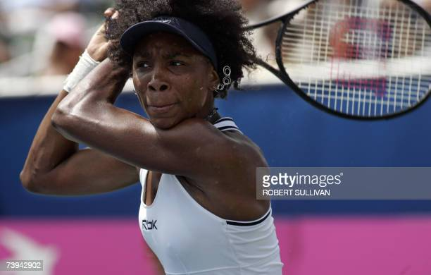 Venus Williams of the US follows through on a return shot in her match against Kirsten Flipken of Belgium in the Fed Cup World Group 2007 first round...