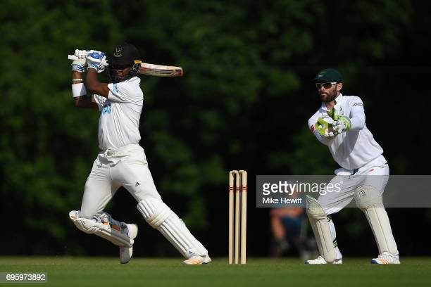 Delray Rawlins of Sussex hits out as wicketkeeper Rudi Second of South Africa A looks on during a Tour Match between Sussex and South Africa A at...